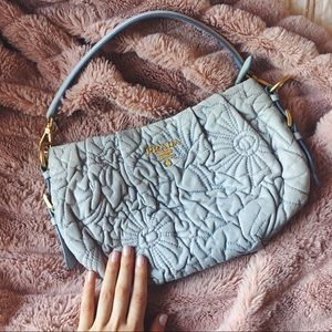 prada • lilac lambskin baguette pochette bag